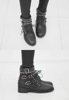 Show your edgy side with these studded lace up boots. The leather boots feature an assortment of pointed and round studs in snazzy silver tone. Wear with a neoprene pullover plus black faux leather leggings. - Round toes - Silver tone studs - Ankle-length - Buckled straps - Lace up front - Side zip closure - Low rise heels - Color: Black