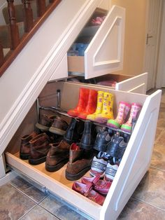 Pull-out under stairs storage for boots and shoes. I love this idea