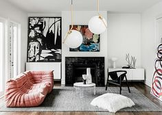This renovation of a 1930s home sympathetically references the original Art Deco features while creating a thoroughly modern home for its art collector owner. Love the play of pink against the predomi
