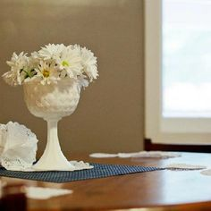 Simple centerpiece- fresh Daisies in a vintage milk glass compote - Vintage ice cream shop birthday party by Let's Have a Ball! Parties & Events