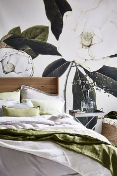 Transform a bedroom with an oversized botanical print mural teamed with bedlinen in neutral shades and green hues. For more bedroom ideas visit housebeautiful.co.uk. (Styling by Hannah Deacon - Photography by Mark Scott).
