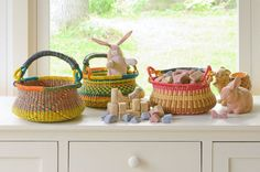 Swing Handled Bolga Baskets. Fair Trade made in Ghana. Great as Easter baskets, for toy storage, or a picnic basket! From www.bellalunatoys.com