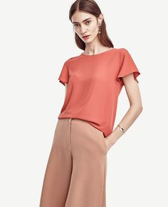 """Crafted+in+luxe+matte+jersey,+this+sophisticated+separate+is+finished+with+airy+flutter+sleeves+for+a+look+that's+polished+yet+carefree.+Jewel+neck.+Flutter+sleeves.+Elliptical+hem.+24""""+front+length;+28+1/2""""+back+length."""