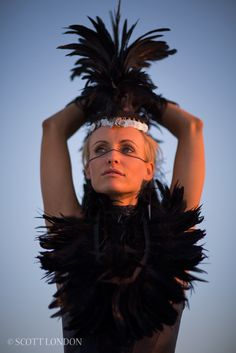 Lia in a feather outfit and headpiece at Burning Man 2013 (Photo by Scott London)