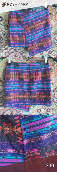 "Topshop Aztec Mini Wrap Asymmetrical Pattern Skirt Faux Leather trim and a fun ombre like Aztec print. Sean Down asymmetrical flap. In excellent condition with no issues. 13.25"" waist and 14"" L with additional 4"" overhang. Topshop Skirts Mini"