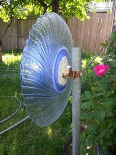 How to Attach a Glass Garden Flower to a Pole