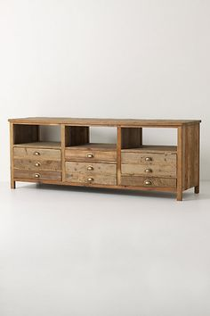 Illusorio console from Anthropologie. The rustic/reclaimed look of this would contrast well with modern accessories.