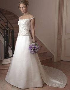 Trendy ISABELLE wedding dress by MILVA designers in Charm Gaby Bridal Gown boutique Tampa FL