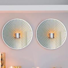 Chic up your wall with a pair of flashy mirrored glass sconces highlighted by golden rays. PURCHASE : http://www.partylite.biz/legacy/sites/nikkihendrix/productcatalog?page=productdetail&sku=P91477S&categoryId=58432&showCrumbs=true