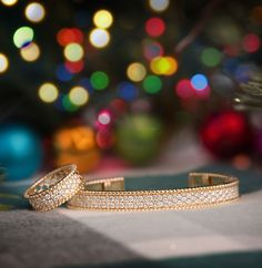 The classic silhouette of the Naledi Collections classic 14K honeycomb style diamond bangle and ring under the tree will make her beam.