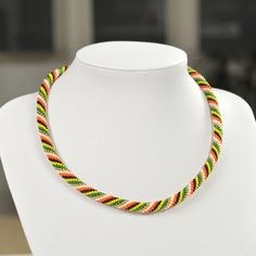 Unique handmade multicolor bead necklace made of gold, yellow, orange, green, red and black beads and white thread.