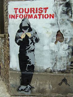 "Street art | Mural ""Tourism Information"" by Banksy"