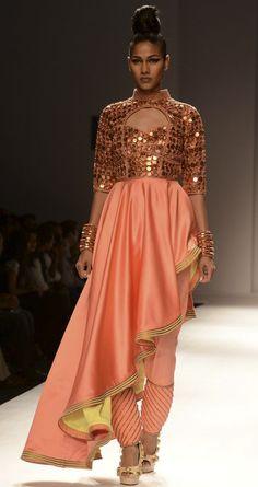 Coral asymmetrical drape top by ANAIKKA. http://www.perniaspopupshop.com/wills-fashion-week/annaikka #fashionweek #willslifestyleindiafashionweek