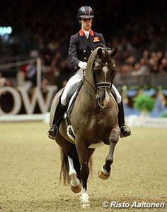 Charlotte Dujardin and Valegro and she is wearing a helmet!