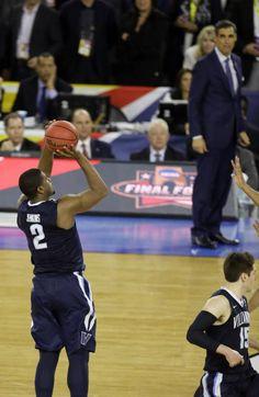 6635fa3408e Villanova's Kris Jenkins (2) shoots a game winning three point basket in  the closing