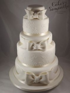4 tier wedding cake - handmade sugar bows and piped lace effect to match the detail on brides wedding dress 4 Tier Wedding Cake, Wedding Cakes With Cupcakes, Bow Cakes, Cupcake Cakes, Spring Wedding, Dream Wedding, Wedding Stuff, Wedding Dress, Cake Makers