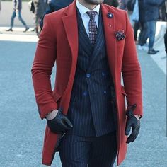 Adding a splash of color to a very dapper outfit.