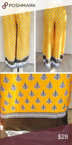Wide leg palazzo pants Very comfortable printed wide leg pants with drawstring . Measures : Length : 42 inseam : 30Material :100%Rayon. Color is bright yellow with green . Pants Wide Leg