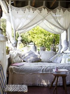Shabby porch...looks comfy! To wake up and see the soft draping gauze-y curtains surrounding my outdoor bed in my she shed, outdoor bedroom....ahhhh!,