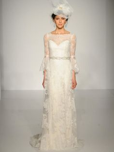 Maggie Sottero lace column gown with illusion neckline and lace sleeves