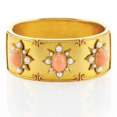 Antique Gold, Coral and Split Pearl Cuff Bangle Bracelet   The wide bangle topped by stylized florets centering 3 oval cabochon coral, framed by split pearl petals, approximately 26.3 dwt. Inner circle 6 1/2 inches. Victorian or Victorian style.