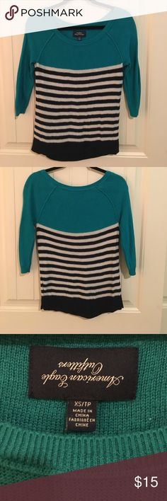 American Eagle • Stripped sweater This sweater is super cute and comfy! It's been lightly worn and idk why the tag is upside down I did not realize that until right now hahaha! It says xs but it's more of a small! American Eagle Outfitters Sweaters Crew & Scoop Necks