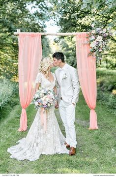 Beautiful pastel inspired wedding with a vintage feel with the bride in a vintage dress and with pastel floral accents
