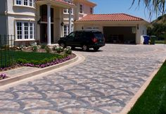 Interlocking concrete paver driveway design by Genesis.