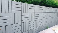 Ikea outdoor RUNNEN Floor decking, goes vertical as a modern fence.