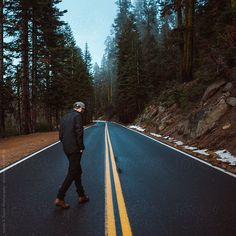 Young man walking down a mountain road by Isaiah & Taylor Photography - Stocksy United Alone Photography, Portrait Photography Men, Road Photography, Photography Poses For Men, Mountain Photography, Walking Poses, Alone Man, Instagram Profile Picture Ideas, Travel Pose