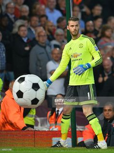 Manchester United's Spanish goalkeeper David de Gea catches an inflatable ball during the English Premier League football match between West Ham United and Manchester United at The Boleyn Ground in Upton Park, in east London on May 10, 2016. / AFP / GLYN KIRK / RESTRICTED TO EDITORIAL USE. No use with unauthorized audio, video, data, fixture lists, club/league logos or 'live' services. Online in-match use limited to 75 images, no video emulation. No use in betting, games or single…