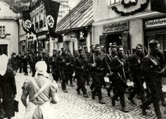 Czechoslovak army leaves Fulnek after the Munich Agreement. The houses are decorated with flags with swastika. Luftwaffe, Munich Agreement, Army History, Armed Forces, Czech Republic, Prague, World War Ii, Troops, Ww2