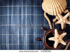 Few nautical items over blue wooden background.