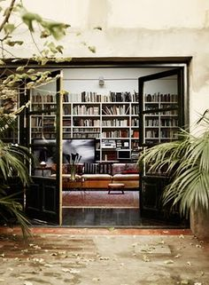A wall of books and an outdoor area to read in? Perfect.