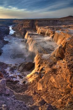 Grand Falls is a natural waterfall system located 30 miles northeast of Flagstaff, Arizona in the Painted Desert on the Navajo Indian Reservation. At 185 feet tall, it is an enormous waterfall higher than Niagara Falls. It dumps snowmelt or monsoon rain into the Little Colorado River below