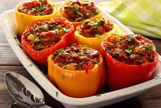 Simple paleo recipe for a saucy beef or turkey mixture stuffed and baked inside fresh bell peppers. Added sausage gives it a little extra kick. Easy recipe!
