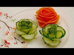 FOOD DECORATION Making Vegetable Flowers Learn How to make Vegetable Carving - Flowers Cucumber with the simple step by step video tutorials online for Free Art of Fruit and Vegetable Carving Garnis. Fruit And Vegetable Carving, Veggie Tray, Cucumber Flower, Vegetable Decoration, Carrot Flowers, Fruit Flowers, Creative Food Art, Food Garnishes, Garnishing