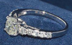Ring (10) Round Diamonds .51ct.tw Center Oval Shape Diamond 1.05ct Clarity VS-2…