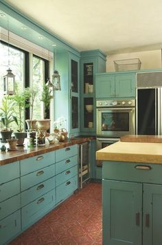 distressed pale blue cabinets with tile floor