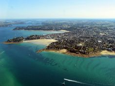 Dinard - can you find the seawater pool? The mouth of the Rance River is to the left and what looks like a bridge crossing the river is the world's first tidal electric dam, opened in 1966.