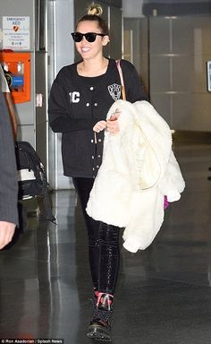 Thrilled: Miley Cyrus  looked positively radiant while she was spotted for the first time ...
