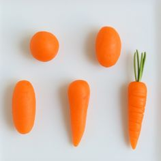 Veggie #2:  Carrot Marzipan  What you need:  marzipan, orange food coloring, fresh rosemary, toothpick, sharp paring knife, fingers  Start with orange tinted marzipan.  Use a toothpick to make a tiny hole on top of the carrot.  Insert a small sprig of fresh rosemary into the hole.  Cut lightly and horizontally with sharp knife for texture.