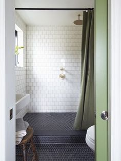 Bathroom:  Dark blue floor, white tile walls