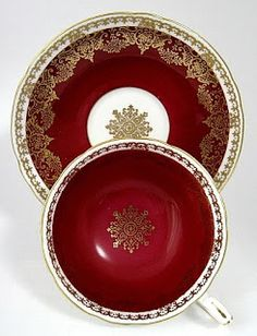 This is a gorgeous Shelley China, England maroon, gold and white bone china teacup and saucer in the Lincoln shape at Antiques And Teacups. The lovely cup and saucer has a gold snowflake overlay pattern and would be perfect with your favorite cup of tea and a few Christmas cookies.