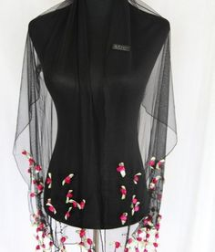Beautiful delicate flowers hand sewn to polyester net. A beautiful and elegant polyester flowered net scarf, ideal for that evening dinner party, with either black, lilac, pink or red flowers.