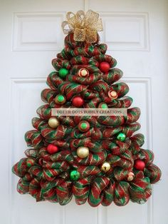 Be the talk of your neighborhood by displaying this Striped Metallic Mesh Door/Wall Lighted Christmas tree wreath on your door, accented with