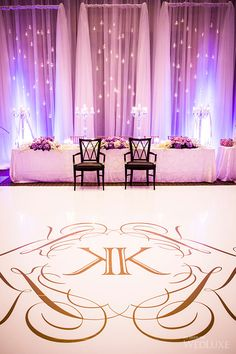 Beautiful photo of a white and gold monogrammed dance floor featured in WedLuxe Magazine