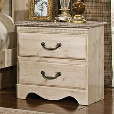 Distressed ivory nightstand.