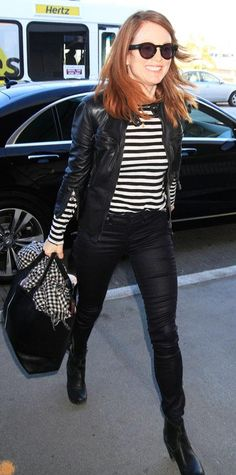 Victoria's Secret supermodel, Behati Prinsloo looks flawless ass she carries her bags through the airport in Los Angeles.