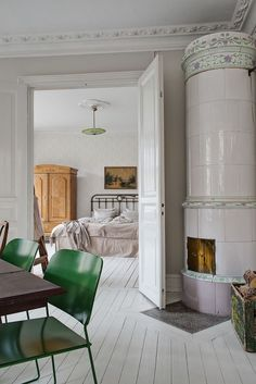 green dining chairs, chimney, Scandinavian homes, white wooden floors